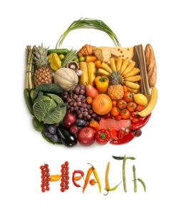 healthy food symbol represented by foods in the shape of a heart to show the health concept of eating well with fruits and vegetables