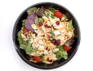 a healthy bowl of fast food salad. too shallow dof, focus is on the bottom of the bowl. ok for small size use