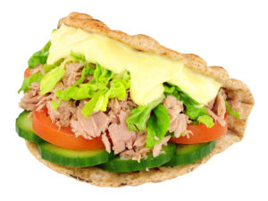 Tuna fish and salad sandwich in a folded flatbread isolated on a white background