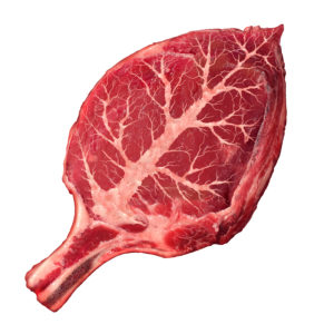 Organic meat and natural food as a raw steak in the shape of a green leaf as a symbol for responsible agriculture and grass fed antibiotics and hormone free organically grown healthy protein source from a certfied beef farm.